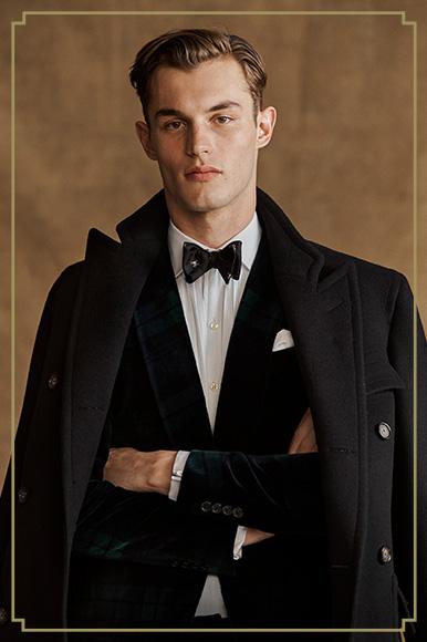Man in velvet tuxedo jacket & silk bow tie