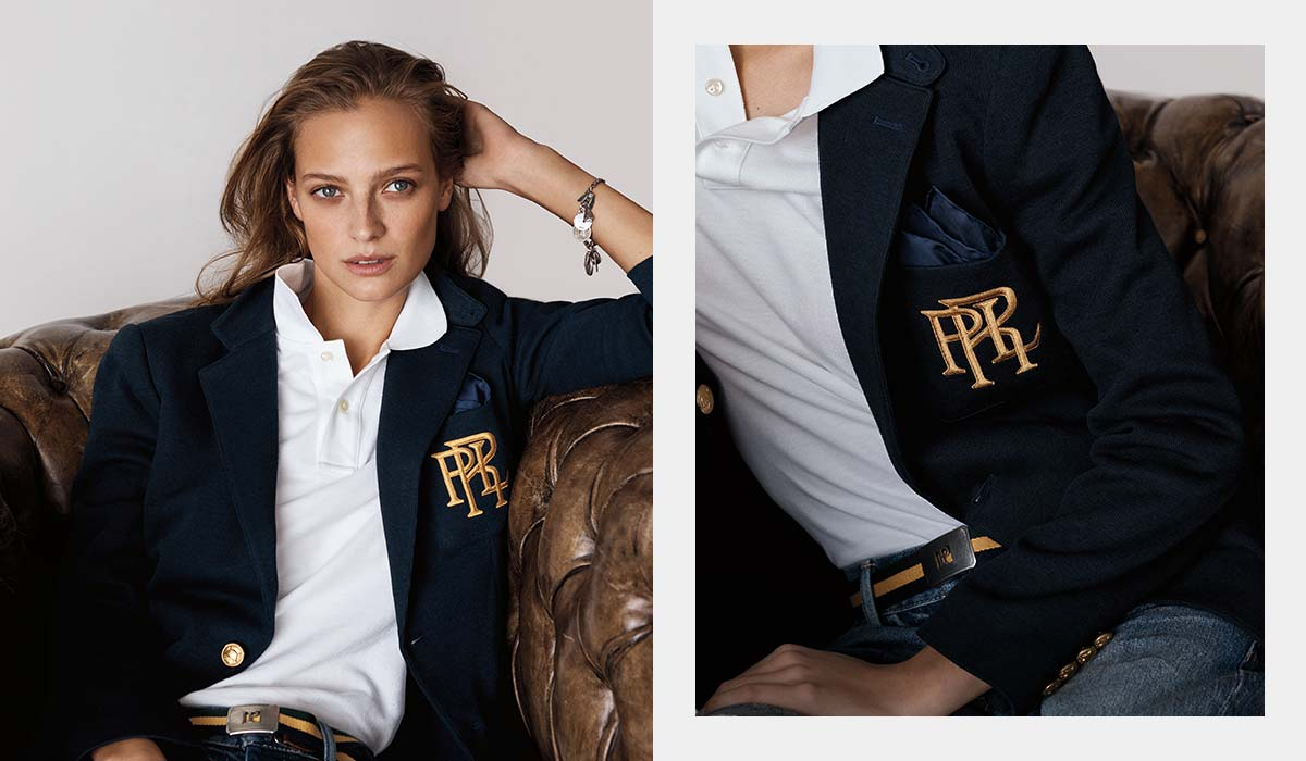 Model in white Polo shirt worn under navy blazer