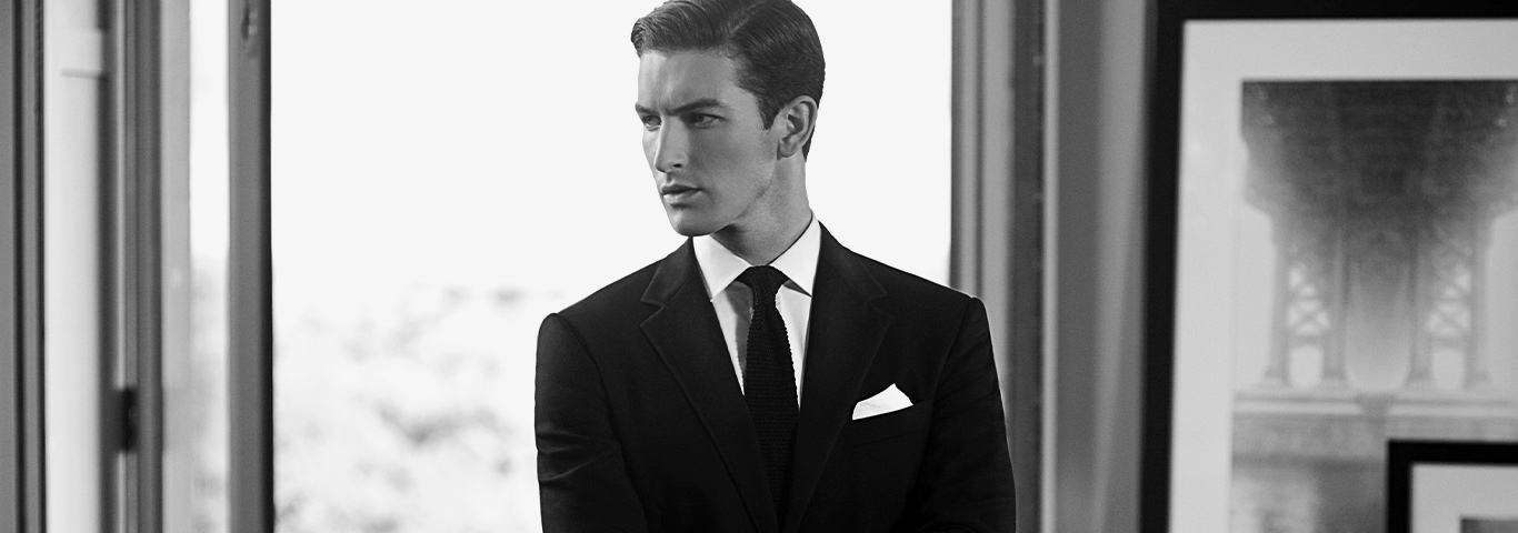 Black & white photo of man in suit