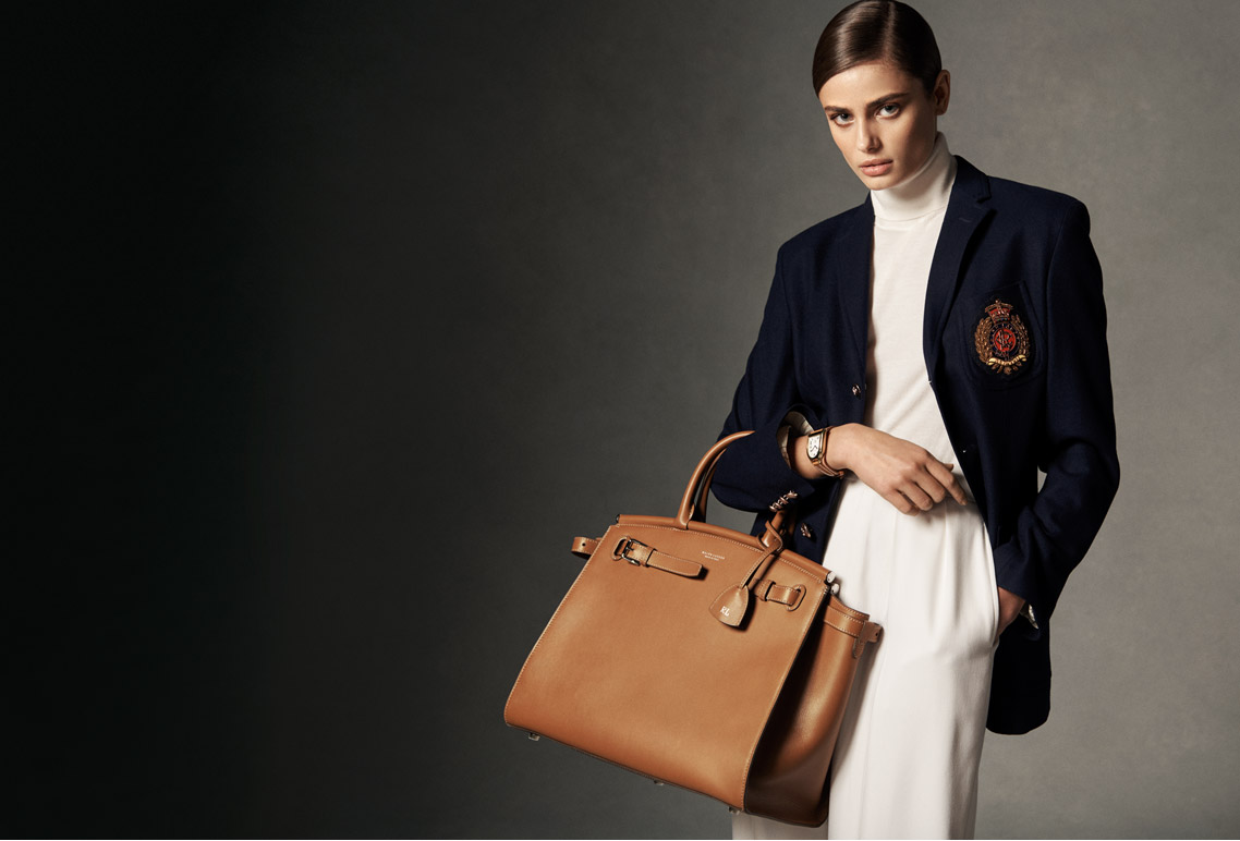 Model carries brown leather RL50 bag.