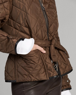 Model in waist-length brown quilted jacket