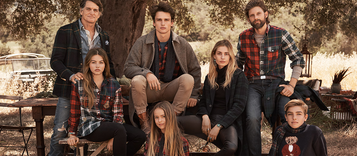 Family wears outfits with various plaid pieces.