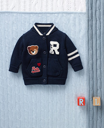 Navy varsity-inspired baseball sweater with patches.