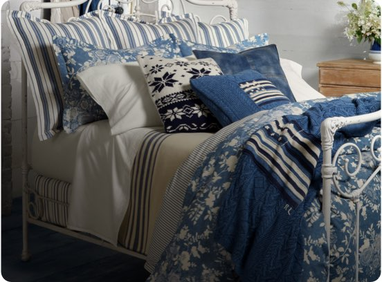 Bed with indigo-dyed and denim sheeting, comforter & pillows.