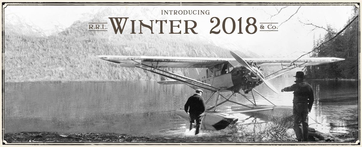 Black & white photograph of biplane landing on water