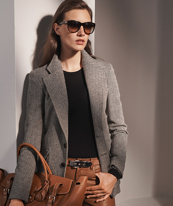 Woman in grey tweed blazer