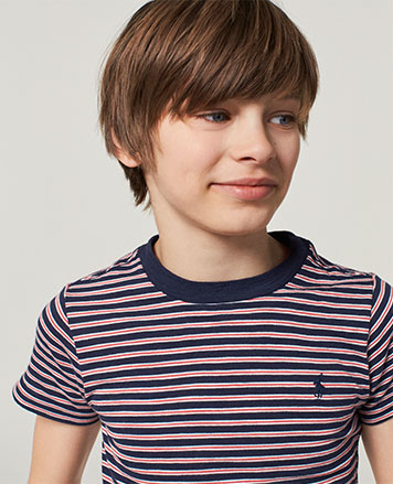 Boy wears red-and-blue striped T-shirt.