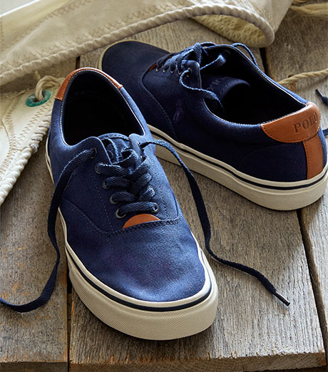 Blue canvas sneakers with leather trim & the Polo logo
