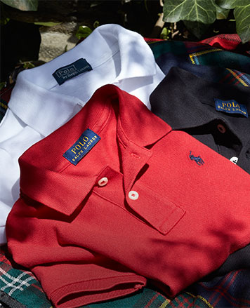 Folded Polo shirts in red, white, and black.
