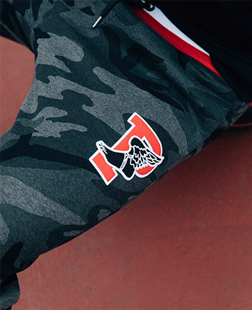 Black & grey camo-print sweatpants with P-Wing logo