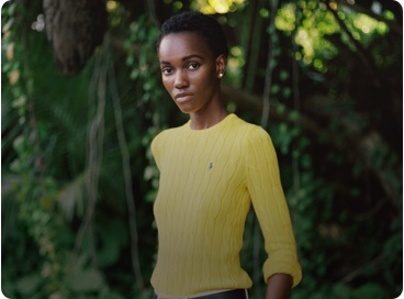 Woman in yellow sweater with Polo Pony accent
