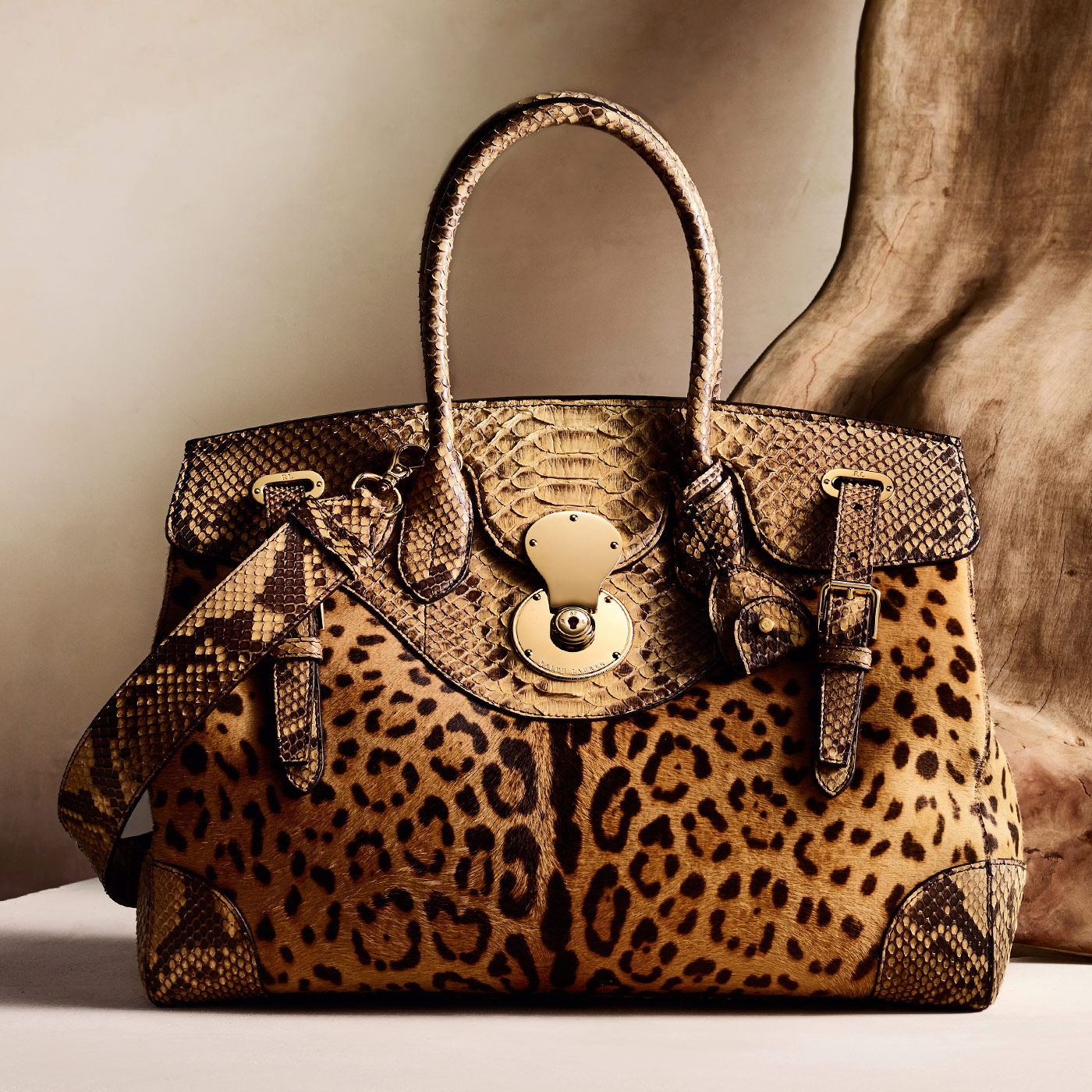 <p><span>A signature Ralph Lauren silhouette, the Ricky creates a dynamic play between texture and pattern using leopard-print haircalf and exotic python</span></p>