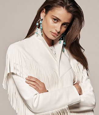 Woman in white leather fringe jacket