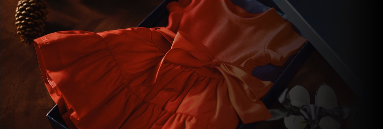 Orange taffeta party dress with large bow at front