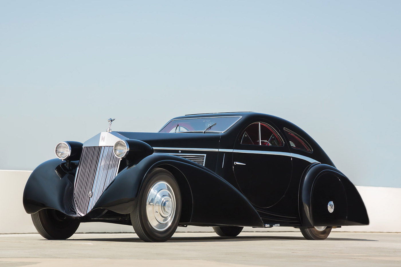 "1925 ""Round Door"" Rolls-Royce Phantom: Re-bodied in 1934, the coupe is known for its sinuous body, low profile, and most of all, its perfectly circular doors"