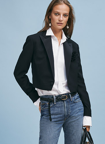 Woman in cropped black tuxedo jacket paired with jeans