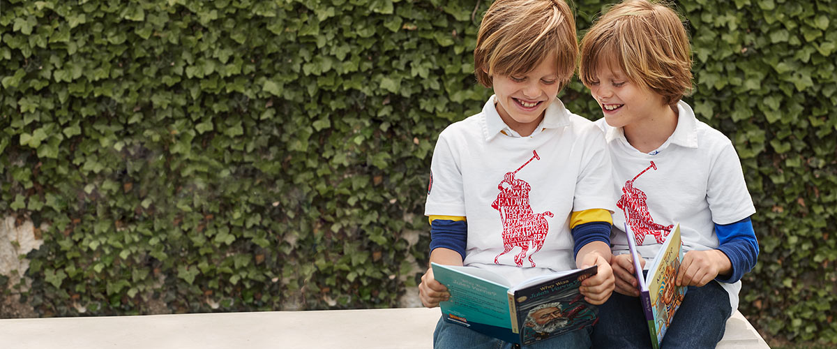 Boys in Literacy tees read books.