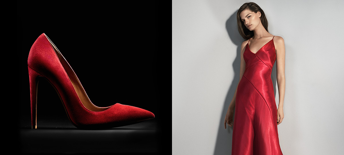 Red suede stiletto; woman wears red silk evening gown.