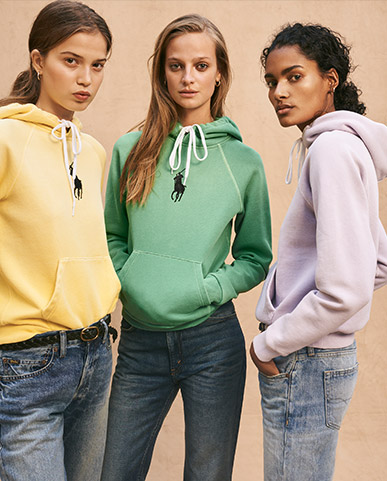 Women in faded pastel-hued hoodies & jeans
