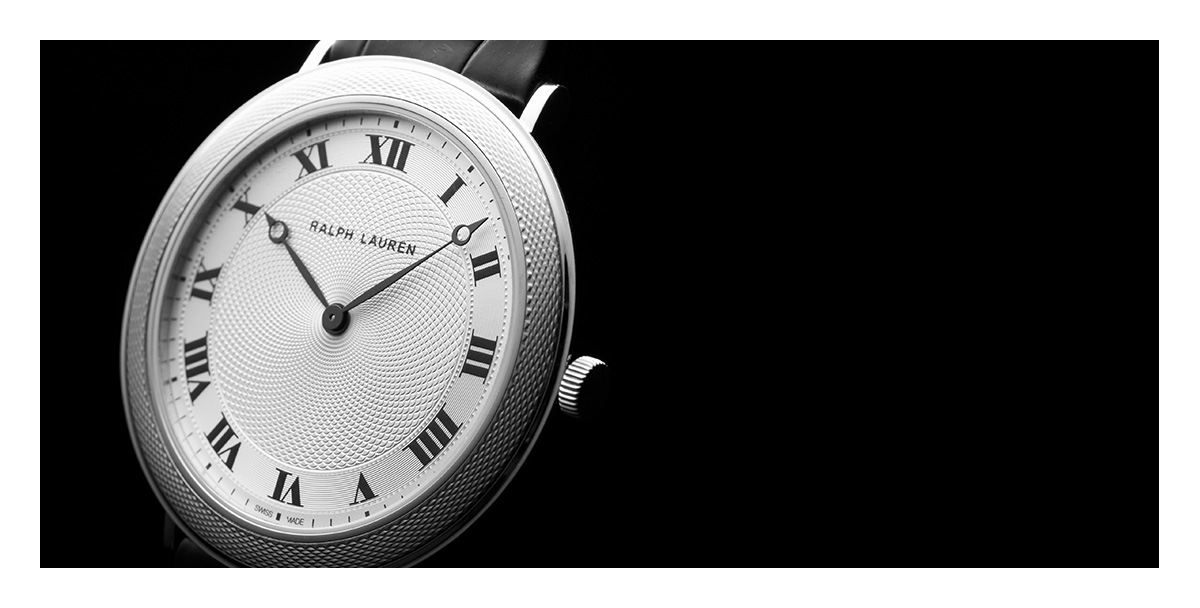 Watch with silver circular face & black leather strap