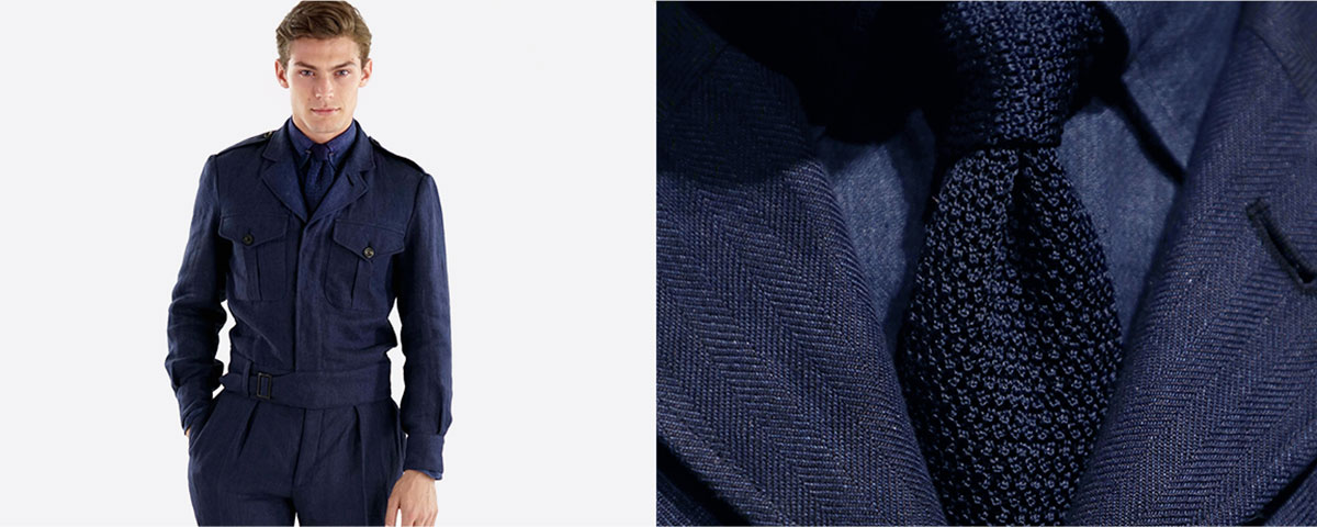 Close-up of navy knit tie paired with matching jacket & shirt
