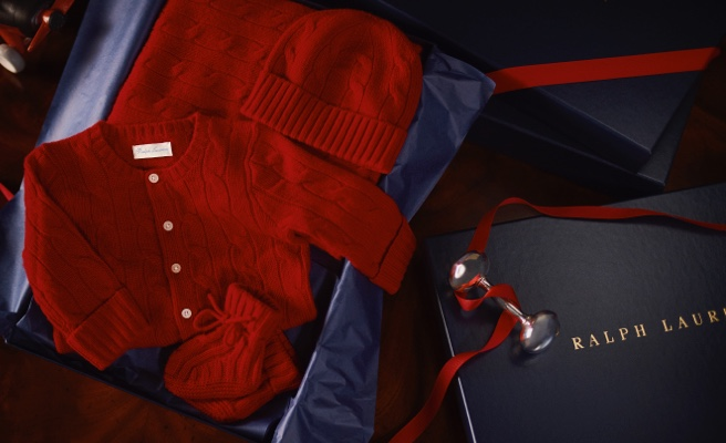 Red knit cashmere hat, booties, and cardigan in navy gift box.