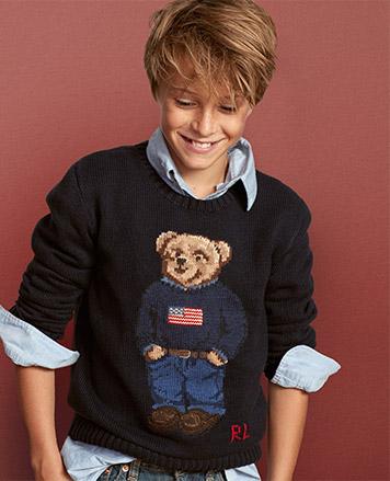Boy wears Polo Bear sweater over chambray shirt.