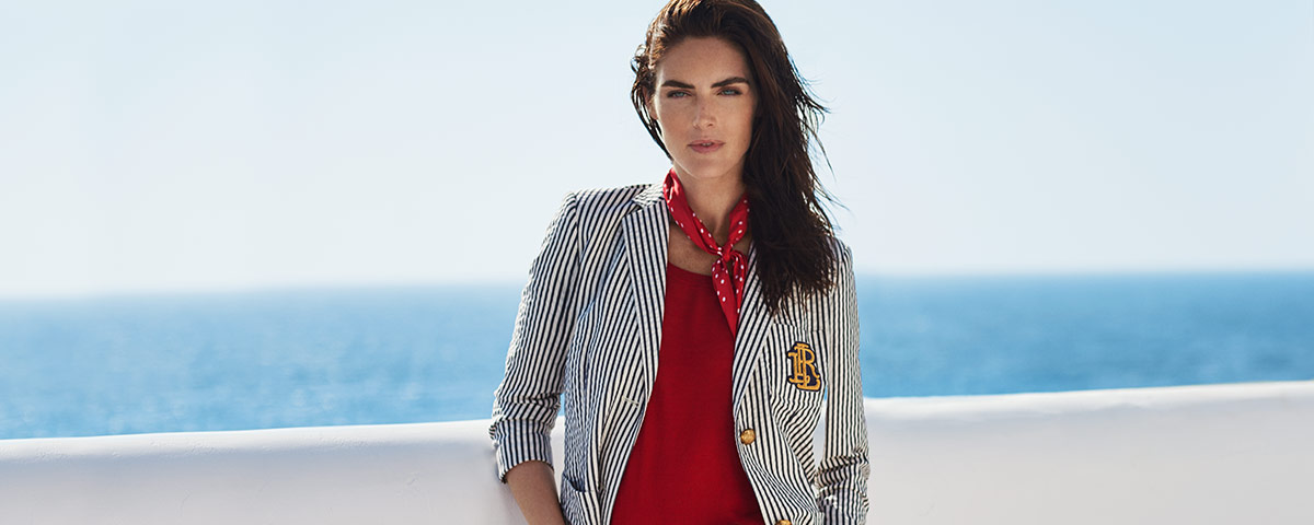 Model in striped black & white blazer layered over red top
