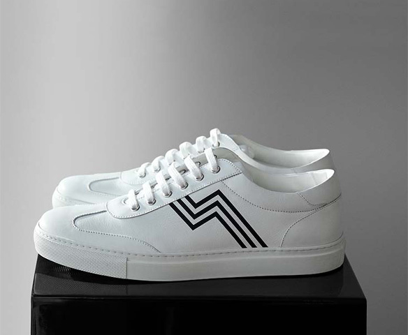 White sneakers with black racing stripe accent