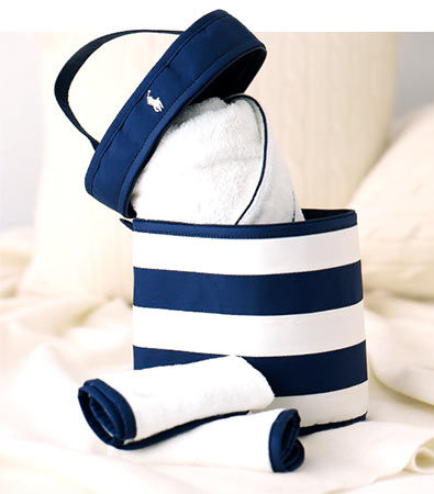 Navy striped carrying case contains white towel & washcloths with navy trim