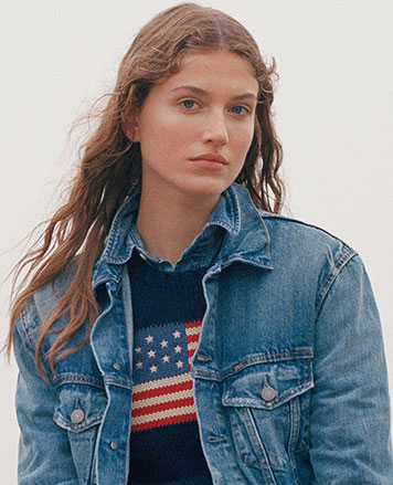 Woman in navy American flag sweater