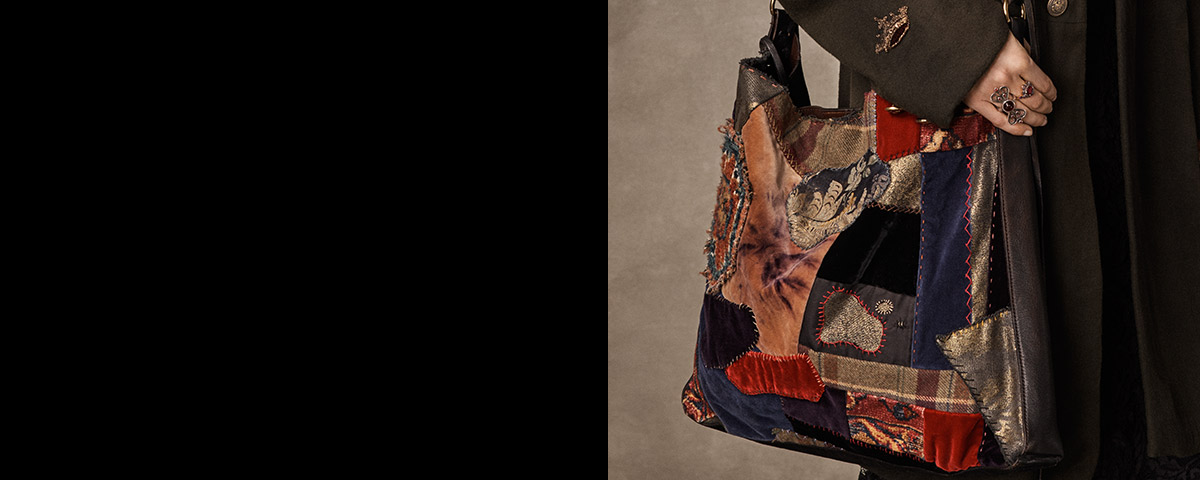 Large handbag with a mix of patchwork designs.