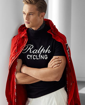 Man wears Tour de Ralph sweater and red anorak