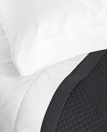White sheets a paired with dark grey duvet