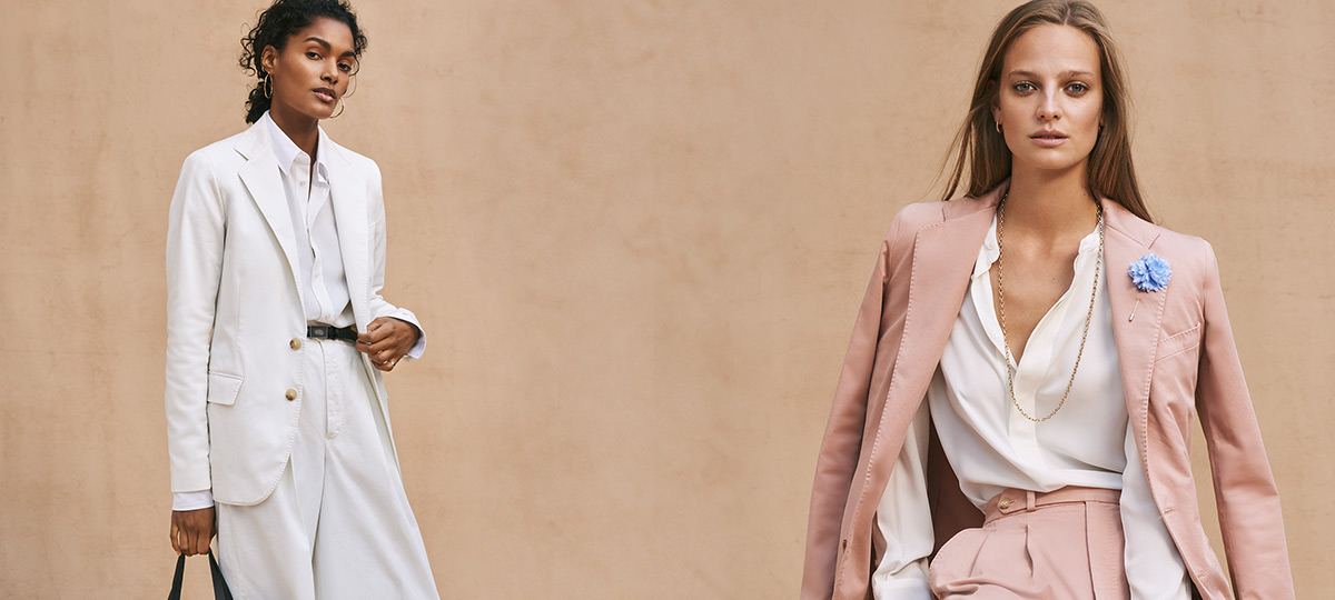 a59e9e7dde95 Woman in wide-leg white suit & woman in blush pink suit