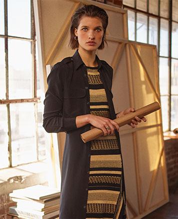 Woman in black & tan striped wrap dress