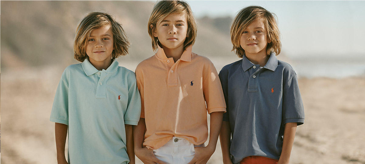 Boys wear Polo shirts in mint green, peach, and slate blue.