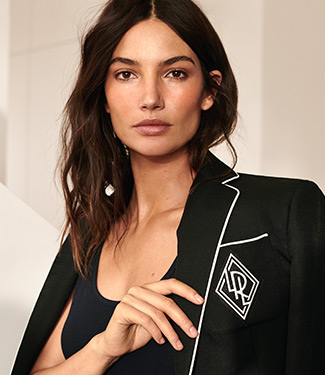 Woman in black blazer with white piping & LRL monogram