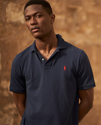 Man in navy Polo shirt with red Polo Pony at chest