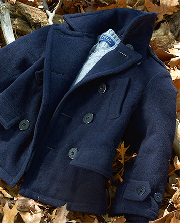 Navy peacoat on background of fall leaves.