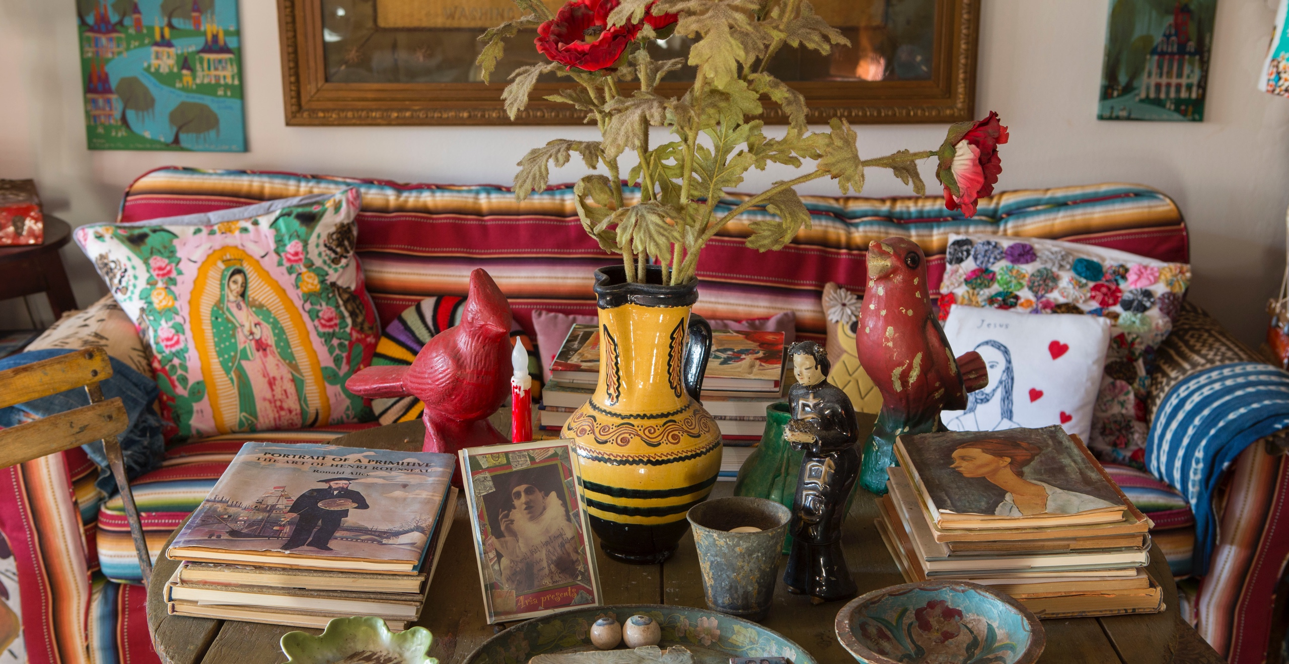 In the author's New York City apartment, an eclectic tabletop exhibit of beloved flea market finds, souvenirs of travel, and gifts from friends