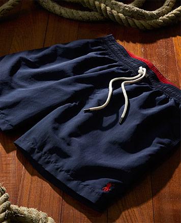 Navy drawstring shorts with red Polo Pony at hem