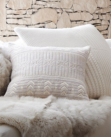 Throw pillows with assorted patterns in neutral tones