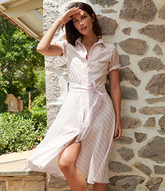 Woman in shirtdress with diagonal pink stripes