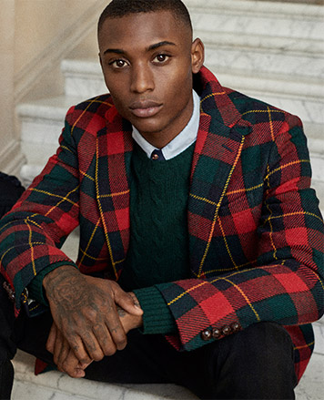 Man in plaid sport coat with braided leather buttons