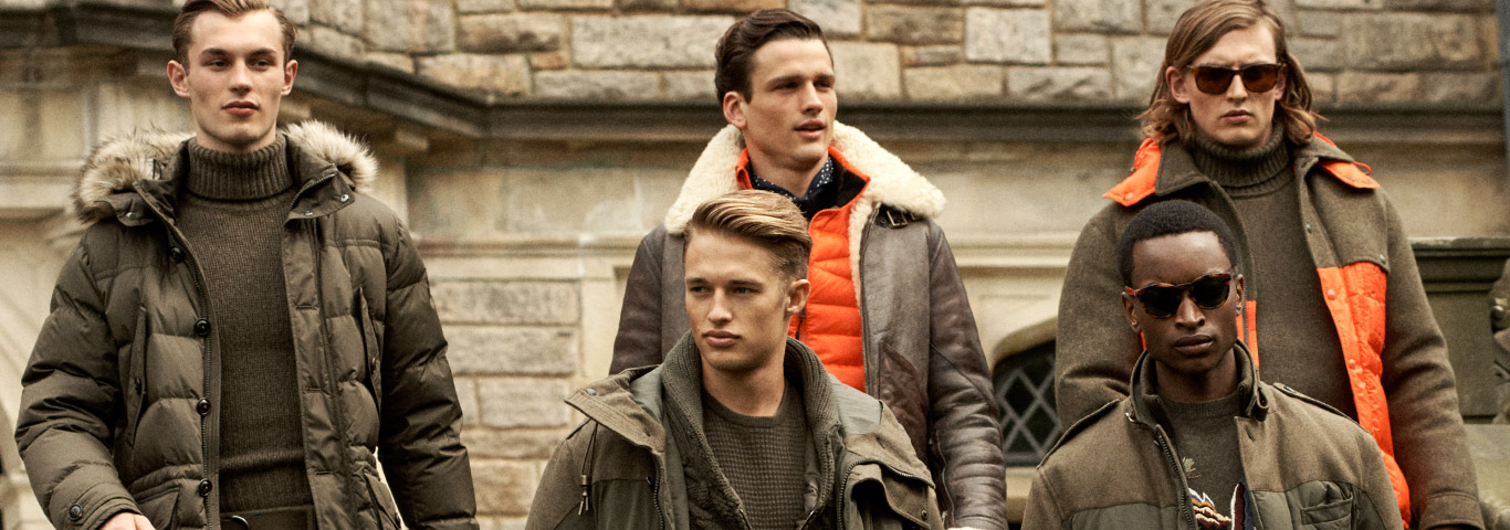 Men in brown-hued cold-weather jackets with orange accents