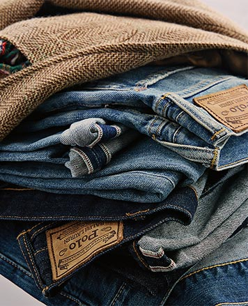 Stack of jeans in various hues