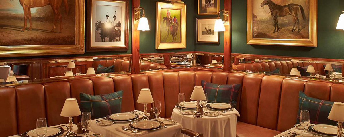 Leather banquettes & plaid cushions at The Polo Bar in NYC