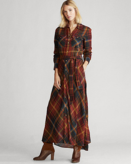 Model in long belted shirtdress in autumn-hued plaid pattern