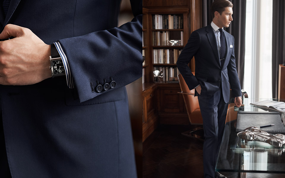 Man in navy suit with buttoned cuffs